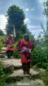 mothers carrying children and firewood