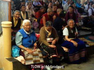 Tibetans praying in dalai lama temple