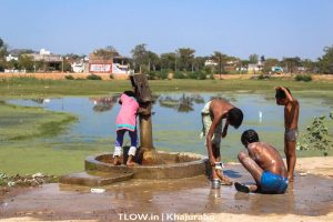 Villagers having a bath near the hand pump